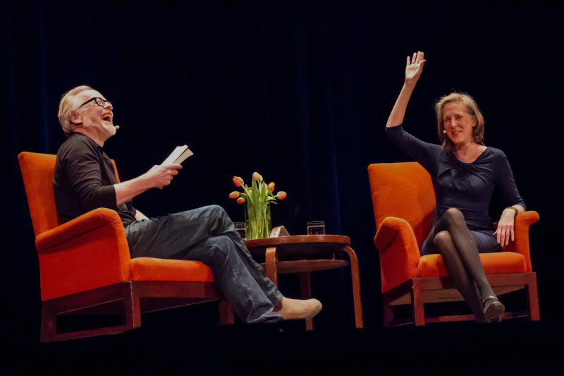 Mary Roach in conversation with Adam Savage in June 2016 - laughing onstage
